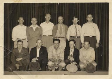 Larry and I believe this to be a photo of a WWII vets support group since we each have the picture but were never told about it. My dad and his dad, Floyd Darby, are front row, 1st & 2nd from left.